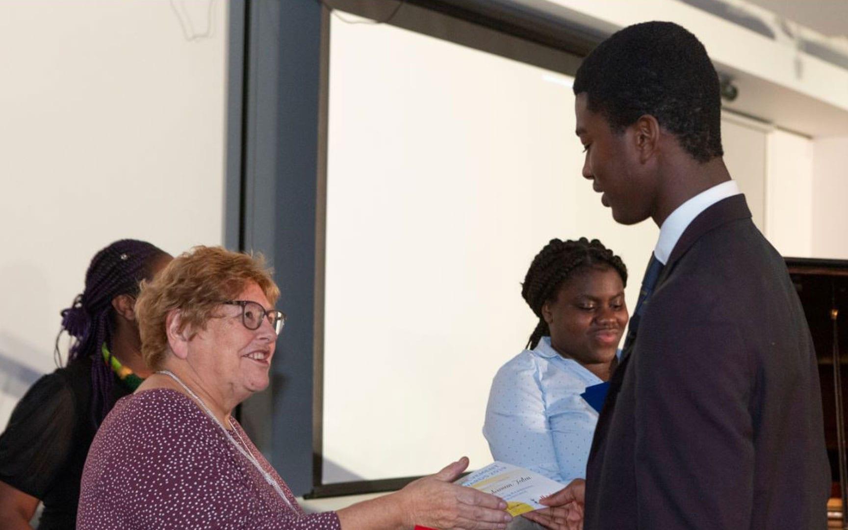 Bereket Receiving His Award