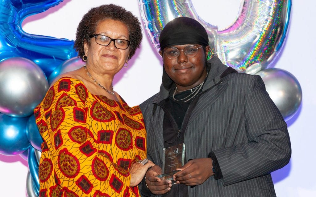 Joe Watson being awarded the Paul Head award by Sarah Ebanja